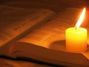 candle on bible